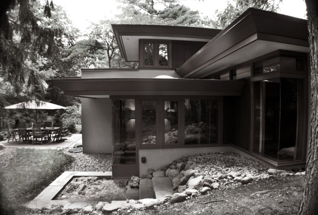 Exterior of porch & bedroom addition with tiered sandbox play area. Rush Creek Village, Worthington, Ohio.