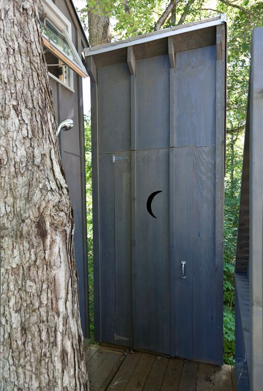 The outhouse door. The Treehouse is also outfitted with an outdoor shower.