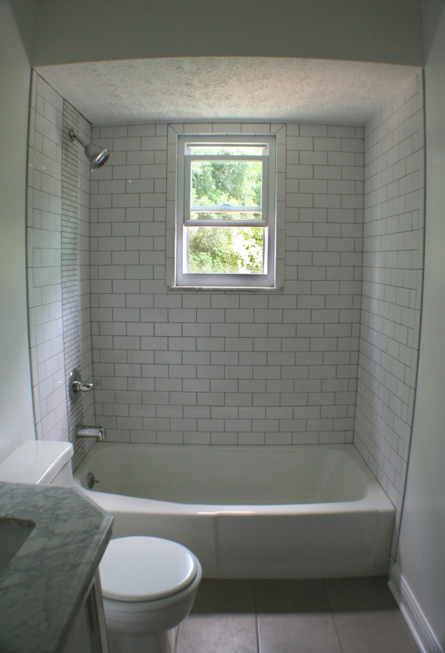 Newly tiled bathroom and fixtures.